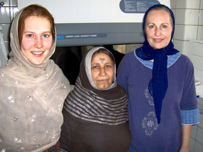 Eckhoff with her mother, Dr. Christina Eckhoff, and an Afghan friend in the lab in Kabul.