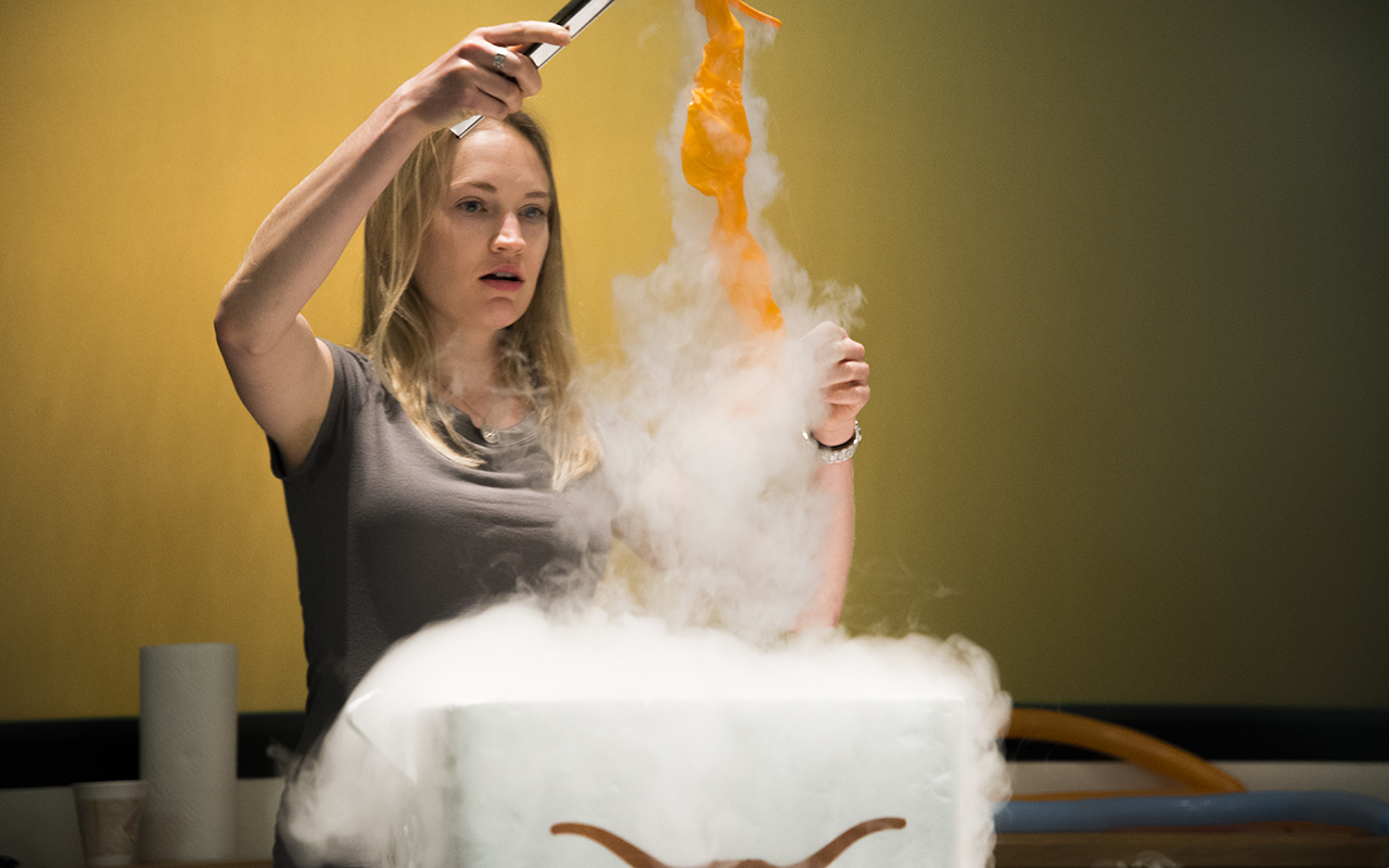 Tess Bernard demonstrates what happens when air in a balloon is cooled in liquid nitrogen. Photo by Jeff Mertz.